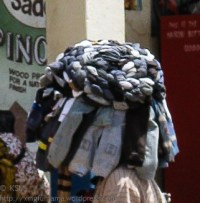 Hat woven of socks worn by a street vendor in Kitui Kenya