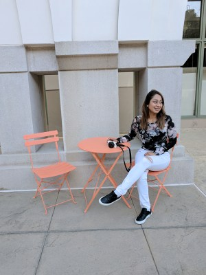girl sitting on a chair with a camera