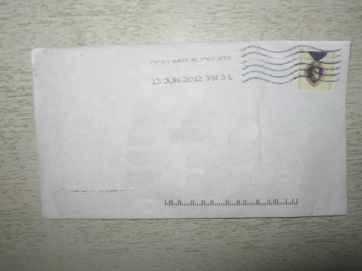 An envelope, poorly edited to remove addresses.