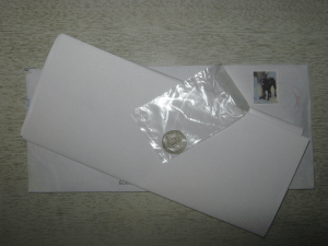 A small coin on a big envelope.