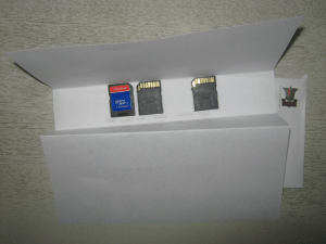 Three microsd to sd card adapters. Also some paper.