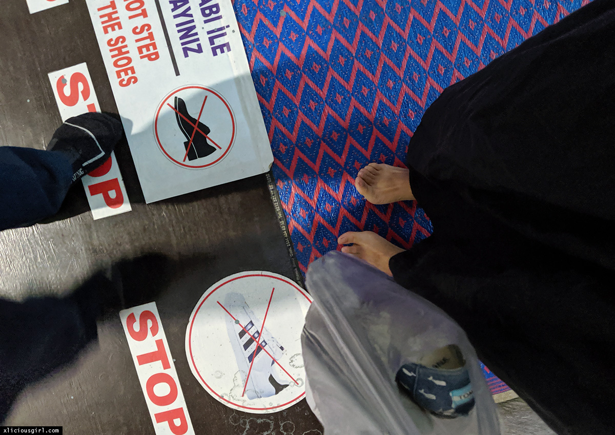 no shoes signage on the floor at the Blue Mosque entrance