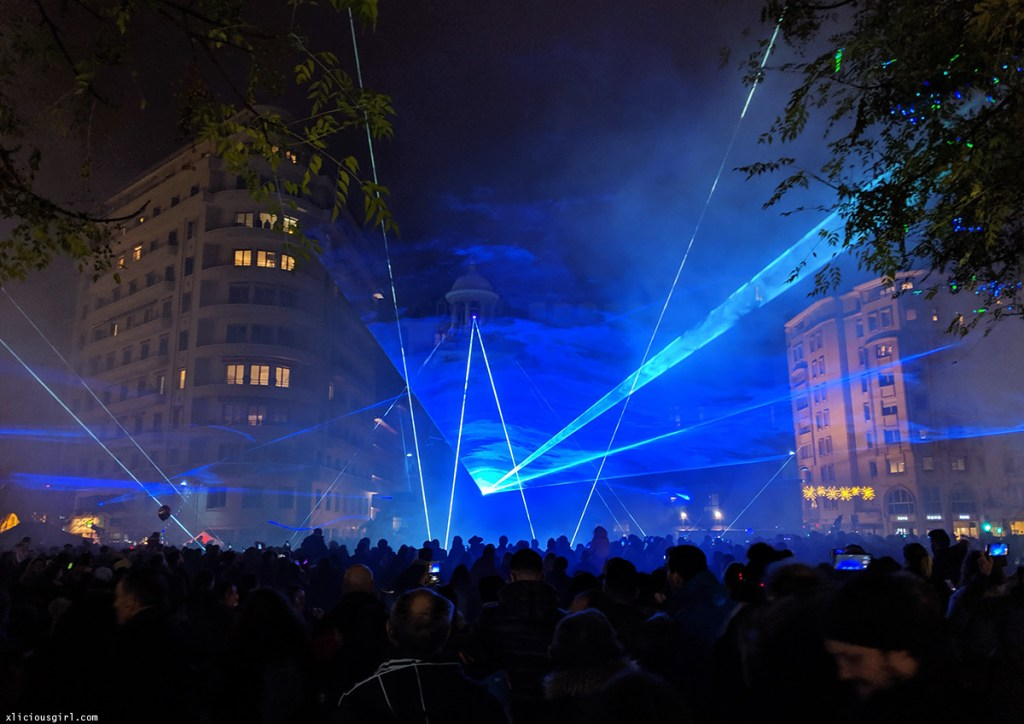 blue led lights and fog glowing over a crowd
