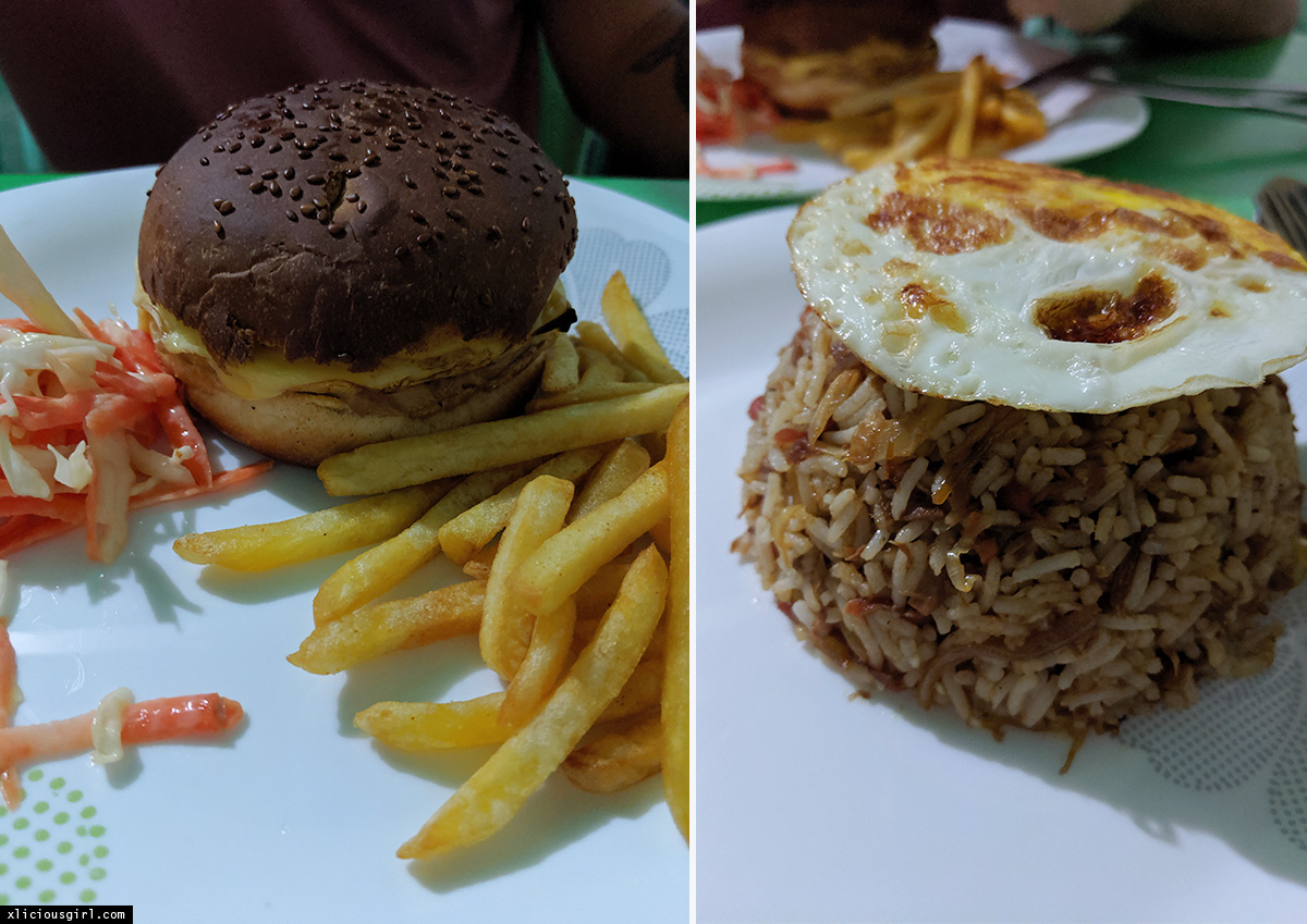 hamburger, fries, and fried egg ontop of rice