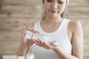 Young women are put in hand lotion