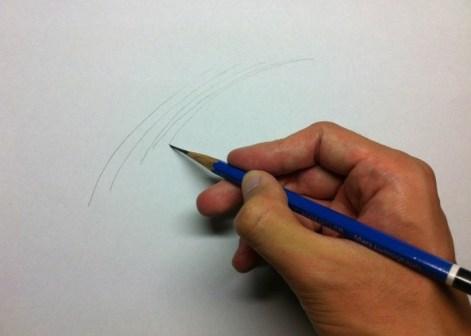 小指を軸に鉛筆で線を描く