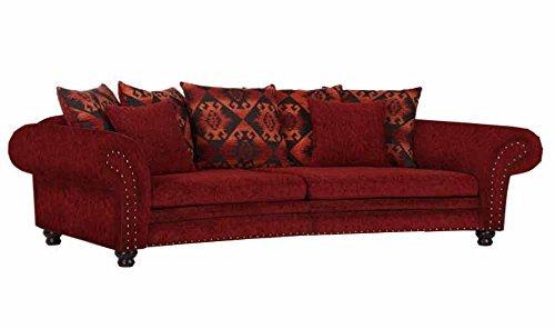 Megasofa rund und 2 kleinen Kissen aus Webstoff in rot und 5 Rückenkissen mit rot schwarzer Musterung, Füße antikfarbig, Maße: B/H/T ca. 276/81/140 cm
