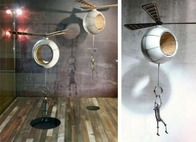 escultura-exhibicion-helicoptero-cuelga-hombre-Greg-Brotherton