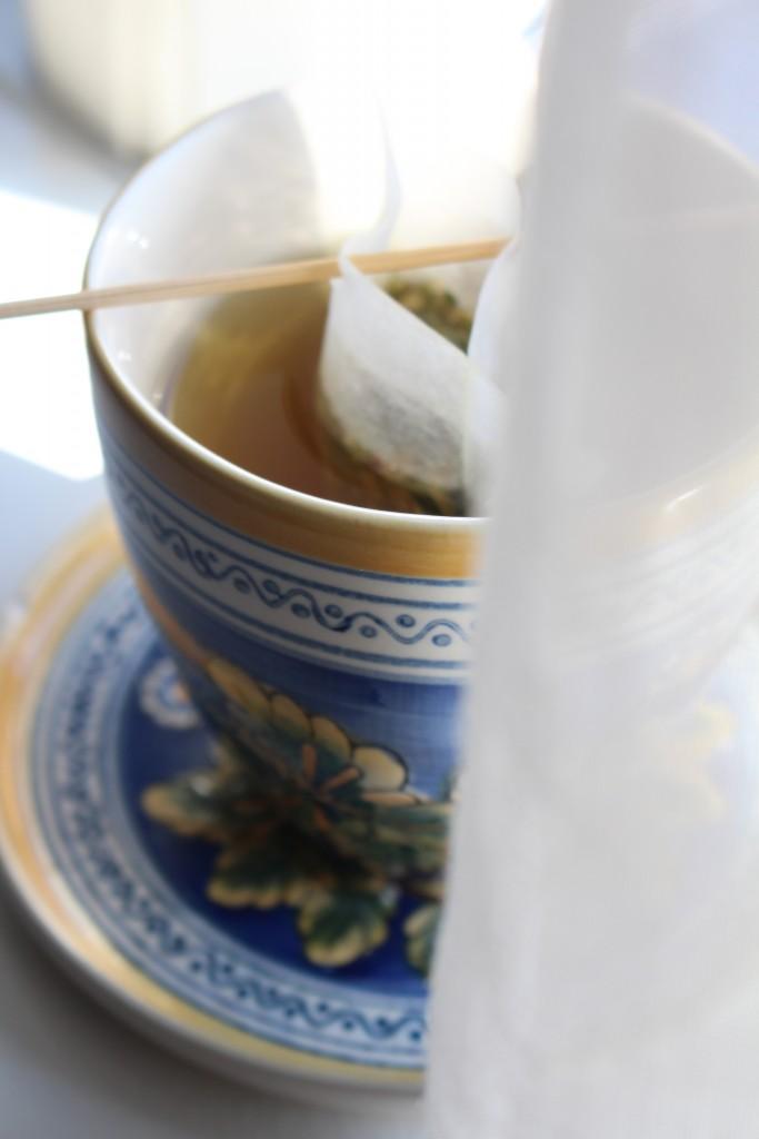 en kop te