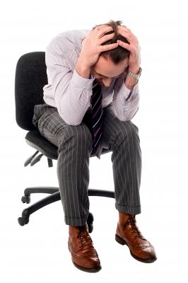 締め付けられる 頭痛