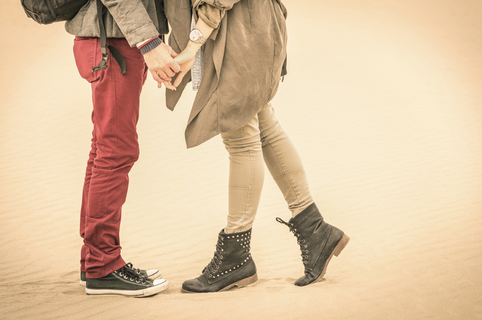 Concept of love in autumn - Couple of young lovers kissing outdo