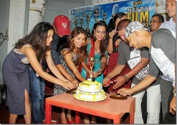 nefta film award nomination cutting cake
