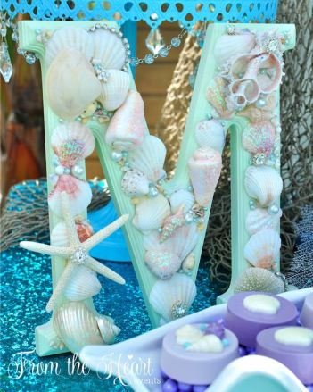 Custom Mermaid letters vintage sea shell sign for DIY under the sea mermaid birthday party. Who doesn't love mermaids?! This is genius! So perfect for kids birthday parties! Under the sea and the little mermaid as a party is awesome! So many DIY ideas that are easy and cheap. Which is even better since we done want to break our budgets throwing a mermaid party. I like the food, dessert, decorating, activity ideas! Love it saving it for later!