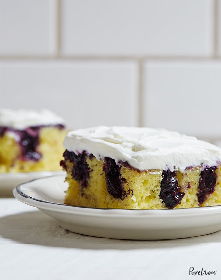 Lemon Blueberry Poke Cake | Poke Cakes make a foolproof, easy dessert every time. These poke cake recipes are quick and easy cakes that you need to try. It's a brilliant way to make delicious desserts every time because most of these poke cake recipe starts with simple store-bought ingredients, you see all the time and probably have in your kitchen already! #xokatierosario #pokecakerecipes #easypokecakerecipes #quickcakerecipes