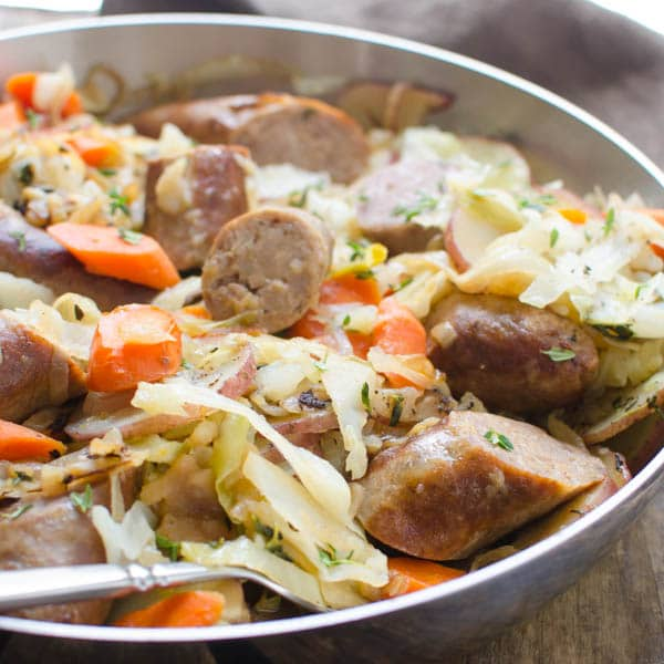 Irish Bangers Skillet   These Irish comfort foods have the spirit of tradition with a fun twist. Irish food is rooted in tradition and is typically stews or long braises which to me is instant comfort foods. These dishes are hearty and just melt in your mouth. Choose from slow cooking stews, pan-fried potatoes, and lots of Guinness beer. #xokatierosario #irishcomfortfood #irishrecipes #stpatricksdayrecipes