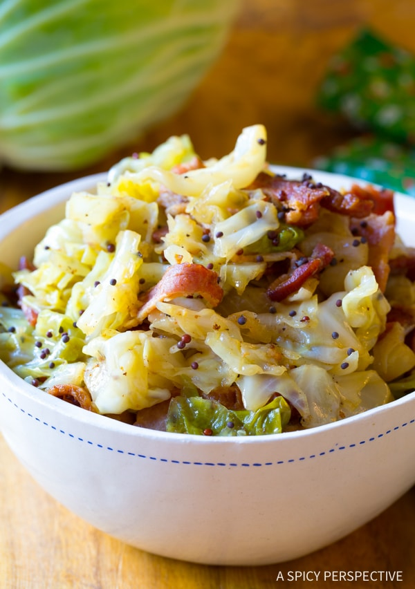 Irish Cabbage Bacon   These Irish comfort foods have the spirit of tradition with a fun twist. Irish food is rooted in tradition and is typically stews or long braises which to me is instant comfort foods. These dishes are hearty and just melt in your mouth. Choose from slow cooking stews, pan-fried potatoes, and lots of Guinness beer. #xokatierosario #irishcomfortfood #irishrecipes #stpatricksdayrecipes
