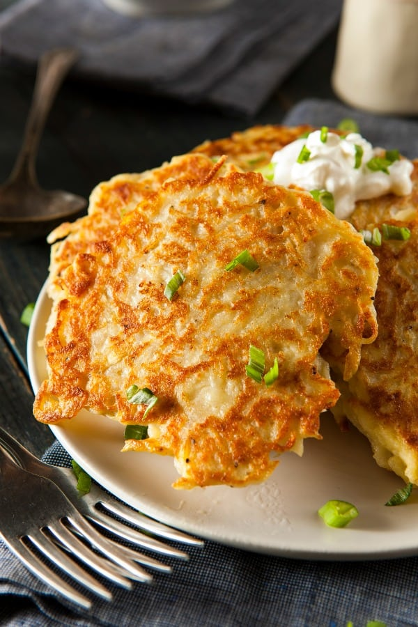 Irish Boxty Potato Pancakes | These Irish comfort foods have the spirit of tradition with a fun twist. Irish food is rooted in tradition and is typically stews or long braises which to me is instant comfort foods. These dishes are hearty and just melt in your mouth. Choose from slow cooking stews, pan-fried potatoes, and lots of Guinness beer. #xokatierosario #irishcomfortfood #irishrecipes #stpatricksdayrecipes