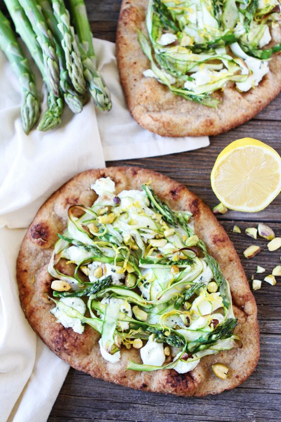 Asparagus Goat Cheese and Pistachio Flatbreads | These Easter brunch recipes are perfect for entertaining or enjoying a weekend brunch any time. You'll happily enjoy these creative brunch recipes on Easter morning. There's many sweet and savory brunch recipe to choose from the easiest french toast bake to a sourdough egg casserole and more. Here are 15 Easter Sunday brunch recipes to feed a crowd! #xokatierosario #easterbrunchrecipes #easterbrunch #easybrunchrecipes
