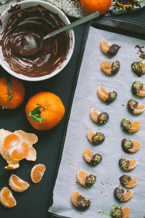 Chocolate Covered Clementines with Pistachios | These spring garden party recipes are light and refreshing and perfect for any outdoor entertaining. With the warmth of spring and all the flowers blooming throwing a garden party is the best way to embrace the new season. These simple garden party recipes are something anyone can make and impress your guests. #xokatierosario #springdinnerideas #gardenpartyfood #easypartyrecipes