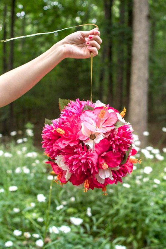 Hanging Flower Balls | The perfect way to welcome the spring is to host a Garden Party. If DIY is your middle name, then you will love these garden party ideas. These garden party ideas are simple and easy to make but will have a significant impact on your garden party. There's no better way to celebrate spring than with a fun and festive DIY garden party. #xokatierosario #DIYgardenpartyideas #easygardenpartyideas #vintagegardenparty