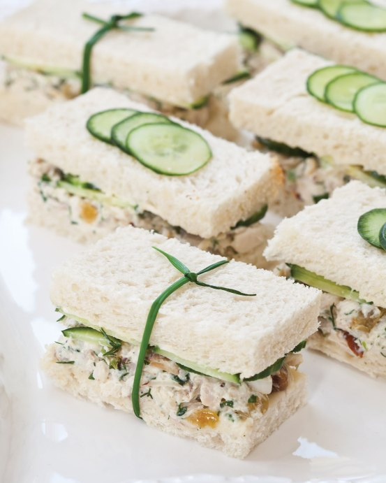Herbed Chicken Salad Tea Sandwiches | These spring garden party recipes are light and refreshing and perfect for any outdoor entertaining. With the warmth of spring and all the flowers blooming throwing a garden party is the best way to embrace the new season. These simple garden party recipes are something anyone can make and impress your guests. #xokatierosario #springdinnerideas #gardenpartyfood #easypartyrecipes