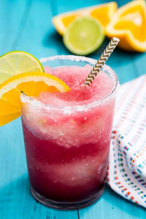 Frozen Sangria Margaritas | What I love most about these margarita recipes is how easily you can make these drinks ahead of time and in large batches. It's really cool how you can take simple ingredients like tequila, fruit juice, and salt and make a ton of delicious flavors. You can choose from bold and flavorful margaritas like coconut grapefruit, blackberry thyme, strawberry basil, and fresh lime & jalapeno. #xokatierosario #cincodemayo #margaritarecipes #easymargaritas