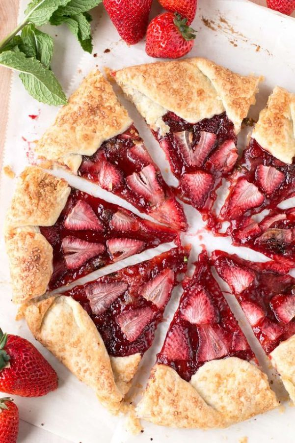 Strawberry Mint Galette | Champagne is a luxurious ingredient that elevates each dessert and makes them the star of the show. These desserts taste not only incredible like a glass of champagne but also look stunning. These Champagne desserts are rich and decadent and perfect for celebrating Mother's Day, Bridal Showers or just because it's the weekend! #xokatierosario #champagnedesserts #champagnerecipes #mothersdayrecipes