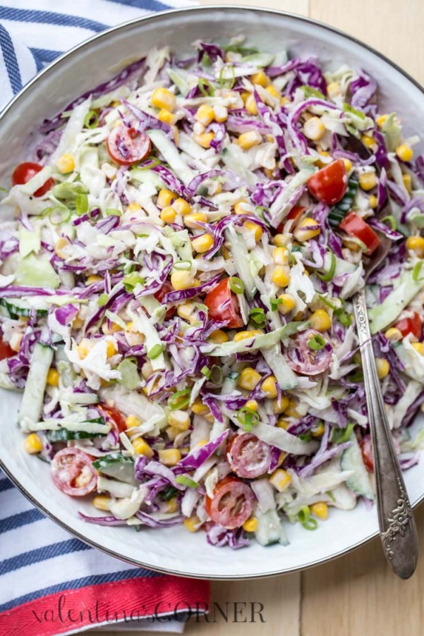 Cabbage Corn Salad   Looking for quick and refreshing picnic recipes? You must try these picnic recipes that are perfect for making ahead of time and eating outdoors. With these summer picnic recipes, all the work is done ahead of time, prepare these delicious recipes at home before storing them in a cooler to take with you. #xokatierosario #picnicrecipes #picnicfoodideas #outdoorentertaining