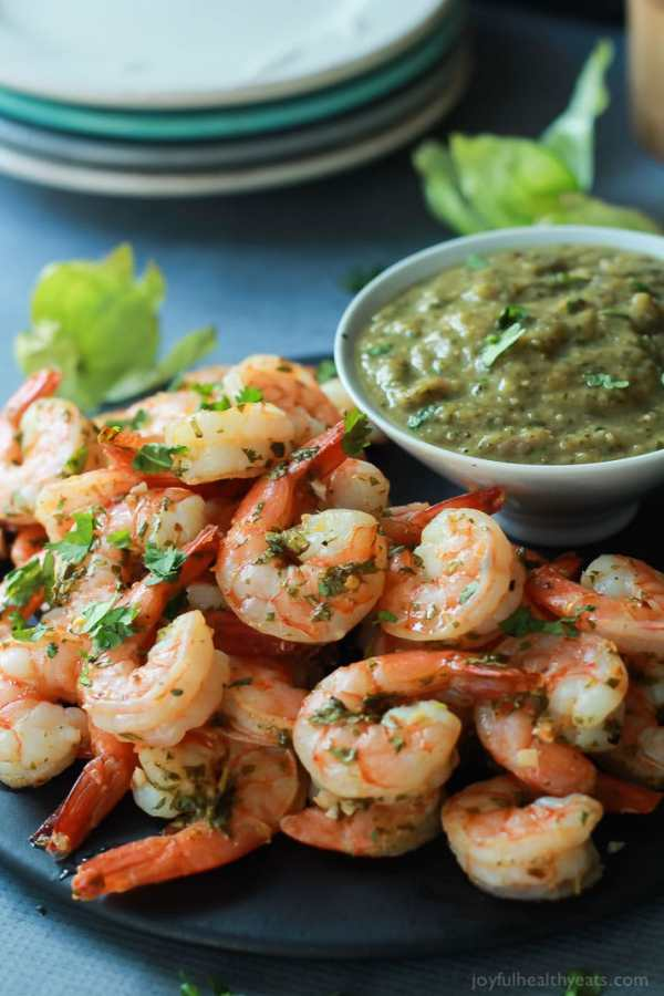 Cilantro Lime Roasted Shrimp with Tomatillo Sauce | Cinco de Mayo is fast approaching, and these easy appetizers are totally perfect for the Spring Holiday! You can choose from Mexican street corn salad, scallop ceviche, white queso dip, and even churros served with a warm chocolate espresso dipping sauce. No matter what you decide to make, you'll love any of these easy Cinco de Mayo appetizers! #xokatierosario #cincodemayo #easyappetizers #cincodemayorecipes