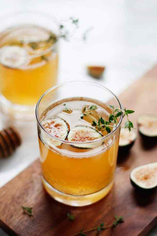 Sparkling Fig Honey Cocktails | These sparkling drinks are fantastic for summer entertaining. Whatever sparkling drinks you choose to make this summer, your thirst will be quenched, and you'll stay relaxed and happy in the summer heat. Here are 14 Sparkling Drinks That'll Keep You So Refreshed! #xokatierosario #sparklingdrinks #sparklingcocktails #sparklingnonalcoholicdrinks #summerentertaining