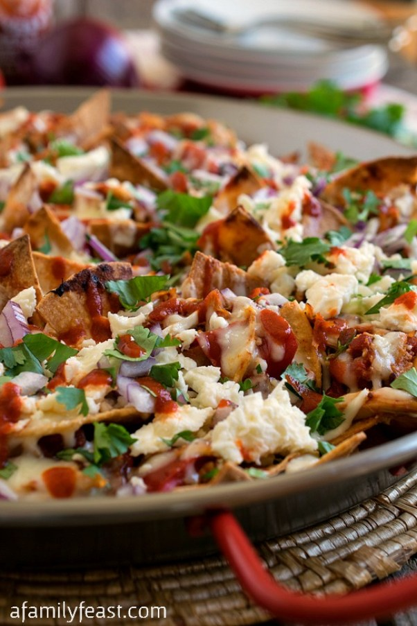Pulled Chicken Chilaquiles | Cinco de Mayo is fast approaching, and these easy appetizers are totally perfect for the Spring Holiday! You can choose from Mexican street corn salad, scallop ceviche, white queso dip, and even churros served with a warm chocolate espresso dipping sauce. No matter what you decide to make, you'll love any of these easy Cinco de Mayo appetizers! #xokatierosario #cincodemayo #easyappetizers #cincodemayorecipes