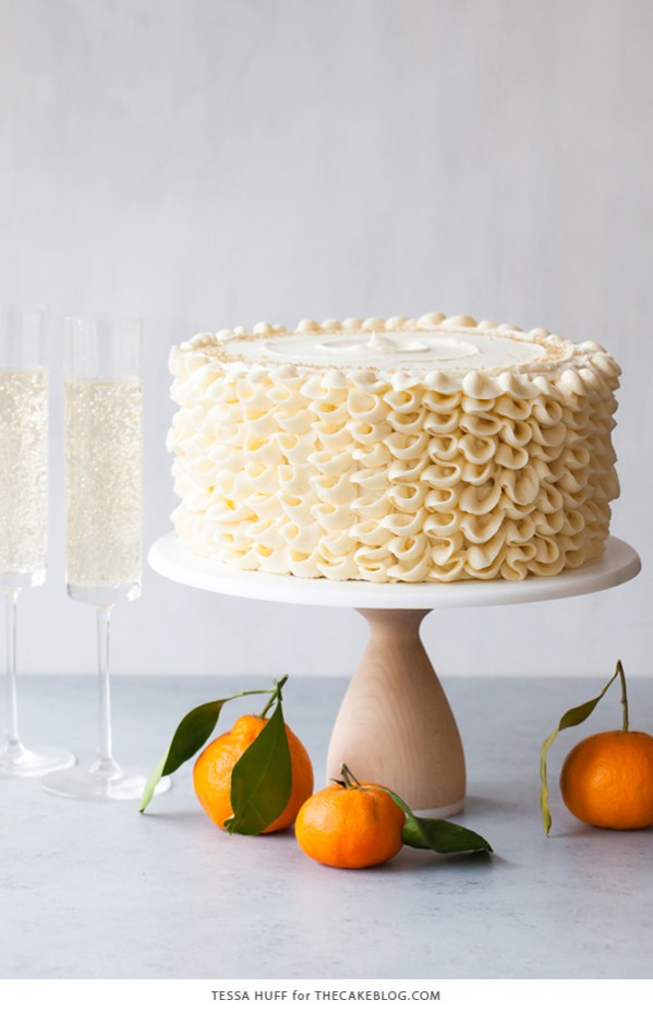 Champagne Mimosa Cake | Champagne is a luxurious ingredient that elevates each dessert and makes them the star of the show. These desserts taste not only incredible like a glass of champagne but also look stunning. These Champagne desserts are rich and decadent and perfect for celebrating Mother's Day, Bridal Showers or just because it's the weekend! #xokatierosario #champagnedesserts #champagnerecipes #mothersdayrecipes
