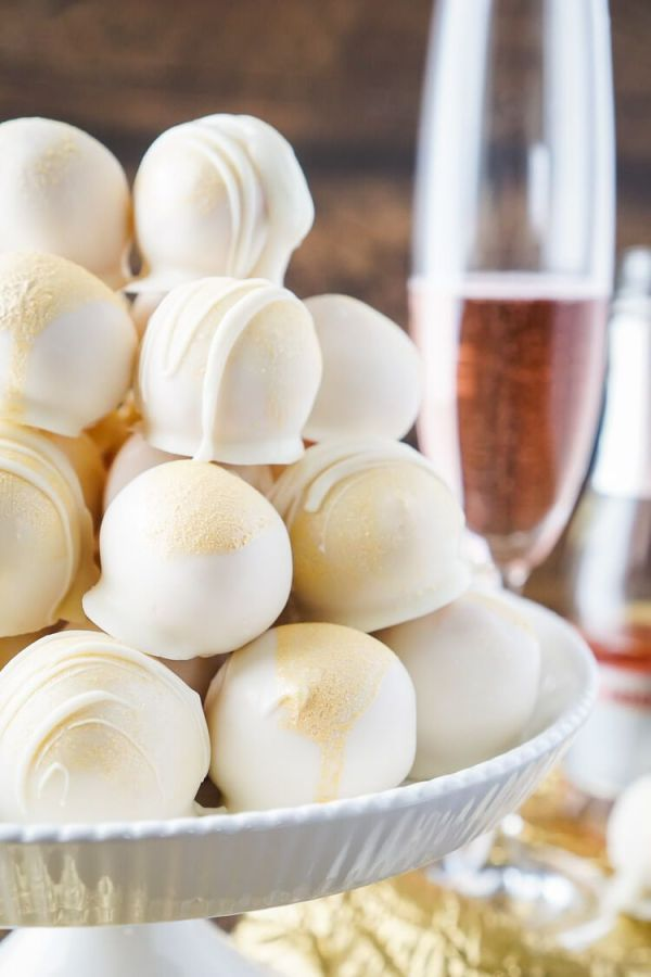 Strawberry & Champagne Cake Balls | Champagne is a luxurious ingredient that elevates each dessert and makes them the star of the show. These desserts taste not only incredible like a glass of champagne but also look stunning. These Champagne desserts are rich and decadent and perfect for celebrating Mother's Day, Bridal Showers or just because it's the weekend! #xokatierosario #champagnedesserts #champagnerecipes #mothersdayrecipes