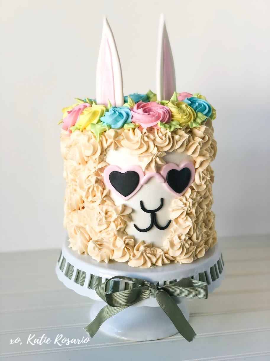 Learn how to make your cool Llama cake with this easy and fun tutorial! I'll show you exactly how to make this party a llama cake at home. Llama cakes have taken over our Instagram and Pinterest feeds and has become the new unicorn cake. Whether you are throwing a llama birthday party or want to create a cool llama cake for fun, this tutorial is for you! #xokatierosario #cakedecoratingtipsandtricks #llamacake #llamabirthdaycake