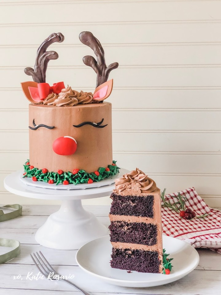 Learn how to make this beautiful Reindeer cake that's totally perfect for Christmas! In this cake tutorial, you'll learn step by step how to make this reindeer buttercream cake at home. My favorite part is teaching you how to make simple fondant decorations that make this cake come to life! It'll be easy to celebrate Christmas with this adorable Reindeer Cake. #xokatierosario #reindeercake #chocolatecakerecipe #buttercreamcakeidea #cakedecoratingtipsandtricks