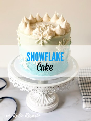 Learn how to make this icy blue snowflake cake that's perfect for winter! This snowflake cake is simply beautiful with the ombre blue on the outside and the sanding sugar giving the cake the ice effect! After making your snowflake cake, you'll feel your confidence rises in the kitchen and feel like you can take on every cake challenge. I can't wait to see your blue ombre snowflake cake creations! #xokatierosario #snowflakecake #wintercakeideas #ombrebuttercreamcake #cakedecoratingtipsandtricks