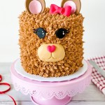 Are you looking for a quick and easy teddy bear cake tutorial? Then this is the cake tutorial for you! I'll show you how to make simple fondant decorations for the features of the teddy bear and use a small star piping tip to make the buttercream fur. There is nothing cuter than an animal cake, and this teddy bear cake is my new obsession! Here's how to make this simply adorable teddy bear cake! #xokatierosario #teddybearcake #bearbuttercreamcake #valentinesdaycake #teddybear