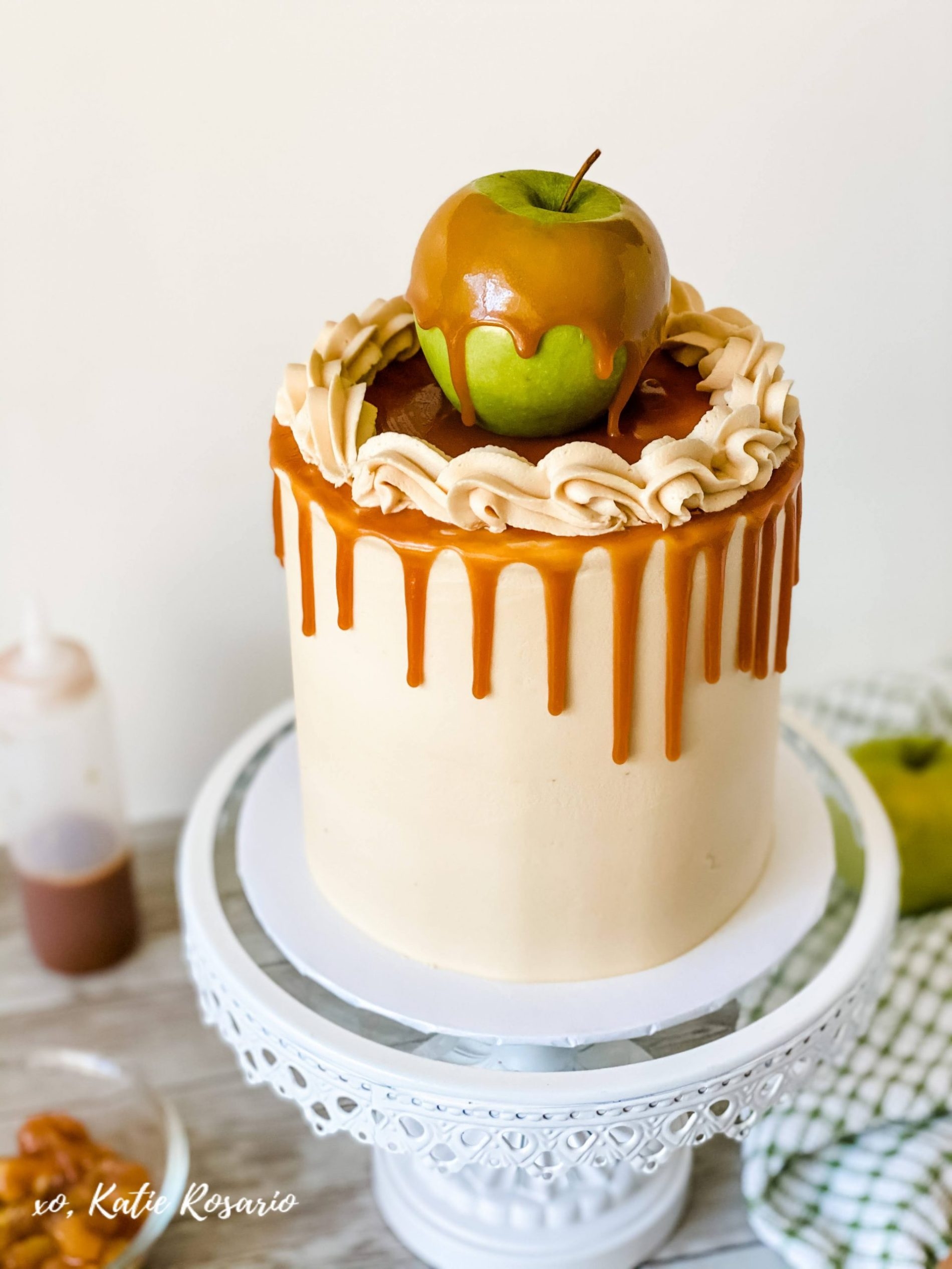 Learn how to make this insanely delicious Caramel Apple Cake. Kick-off apple season with this delicious Caramel Apple Cake! A caramel cake made with apple pie filling, paired with caramel buttercream and caramel drizzle. This Caramel Apple Cake has a beautiful balance of sweet, salty, and full of warm fall spices.