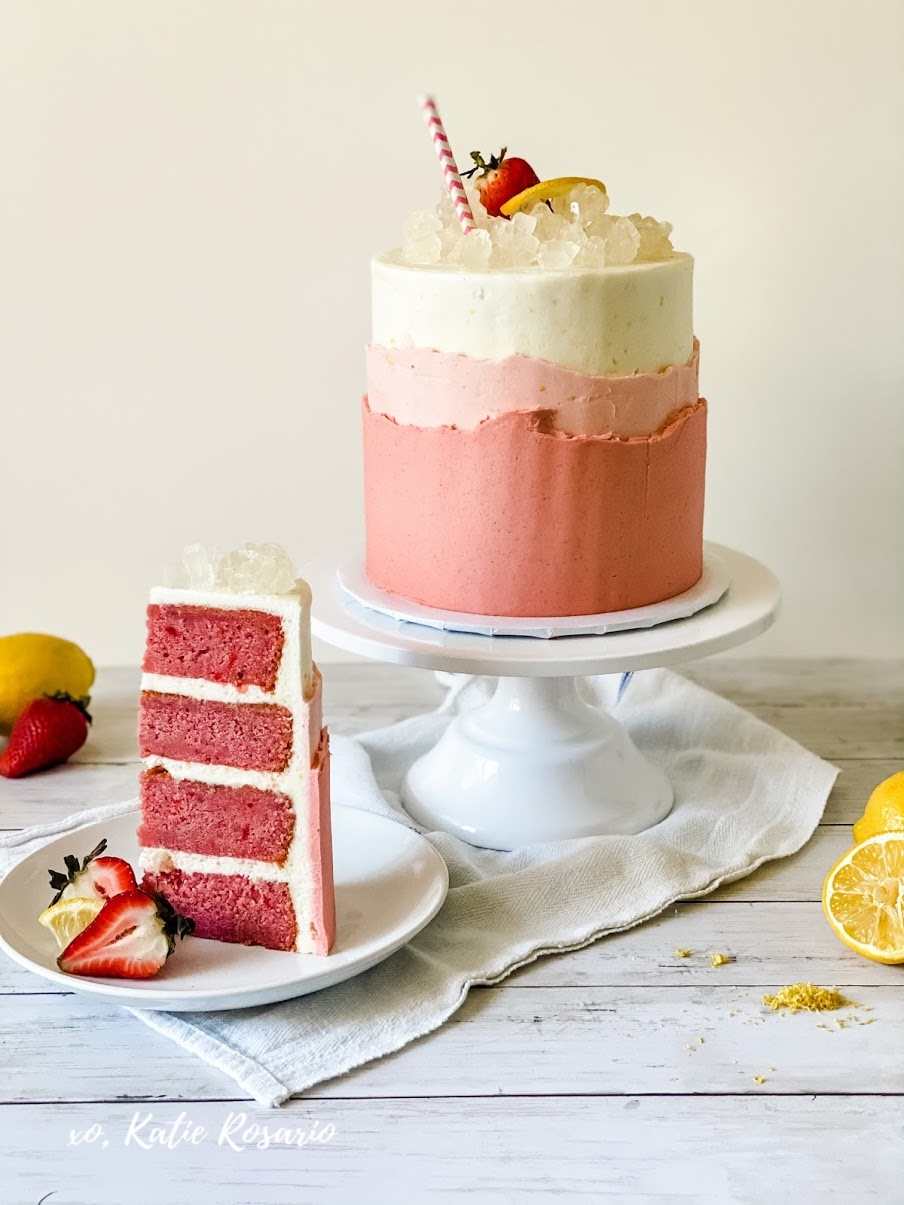 I think this strawberry lemonade cake perfectly describes an awesome summer! This Strawberry Lemonade Cake is made with sweet strawberry cake layers, tart lemon buttercream, and creamy strawberry buttercream that's topped with rock candy! Created by Katie Rosario, XOKatieRosario creates beautiful cake decorating techniques that are easy for beginners and strategically designed for any home baker. #xokatierosario.com #xokatierosario #katierosariocakes #strawberryllemonade #strawberrycake