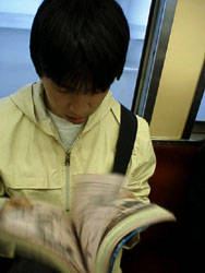 Boy reading manga