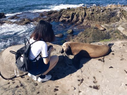 My sister seconds before the sea lion growled at her