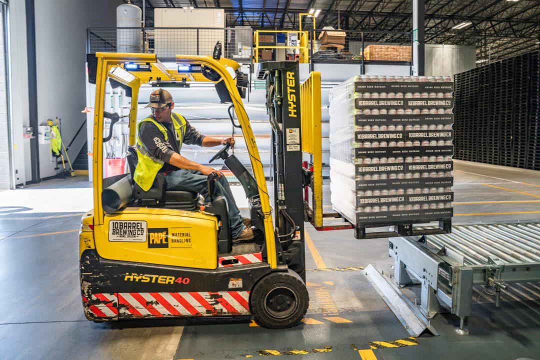 Photo of fork lift driver moving beer