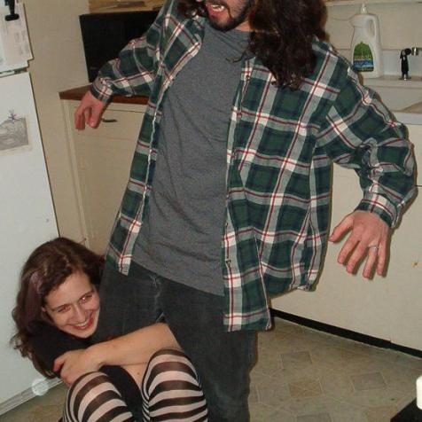 """Rachel and Miles of 2003, testing out early """"Who Would Win in a Fight"""" hypotheses. Rachel hasn't had long hair in years, but she still fights dirty."""