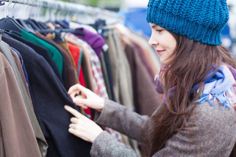 bigstock-Woman-Choosing-Clothes-At-Flea-44441269
