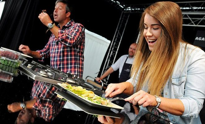 The annual Bolton Food and Drink festival drew in a large crowd this Sunday where revellers soaked up the atmosphere. Star attractions on the day were chefs John Torode of Masterchef fame and Aiden Byrne from the Manchester House restaurant. John Torode with Michaela Daubney from Bolton who judged the competition. Picture by Paul Heyes, Sunday August 24, 2014.