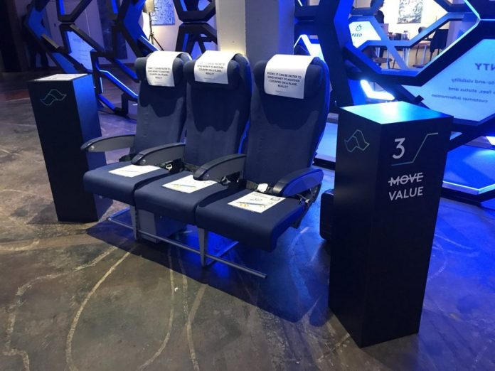 Ripple's Swell conference 2018, xRapid being used demo airplane chairs.