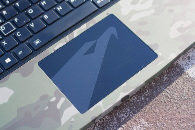 The trackpad continues the theme, with another Aorus logo rendered in light grey on a black background. The trackpad is glass, and feels super smooth under the finger.