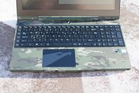 The laptop includes a full keyboard, including a line of macro keys on the left and a number pad on the right. The combination of the MultiCam and the black keys and trackpad is a nice one.