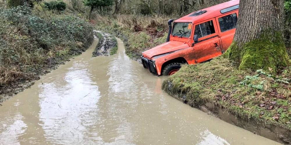 An Orangeworks off-road vehicle driving through the off-road adventure course at Carton House, Maynooth.