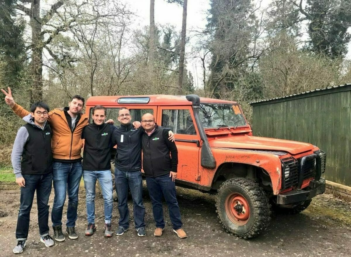 People standing beside Orangeworks land rover vehicle about to start their off-road driving experience at Carton House.